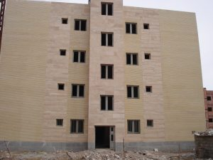 The project includes 18 blocks and 263 four - storey residential units in the Khajoo town of Kerman .